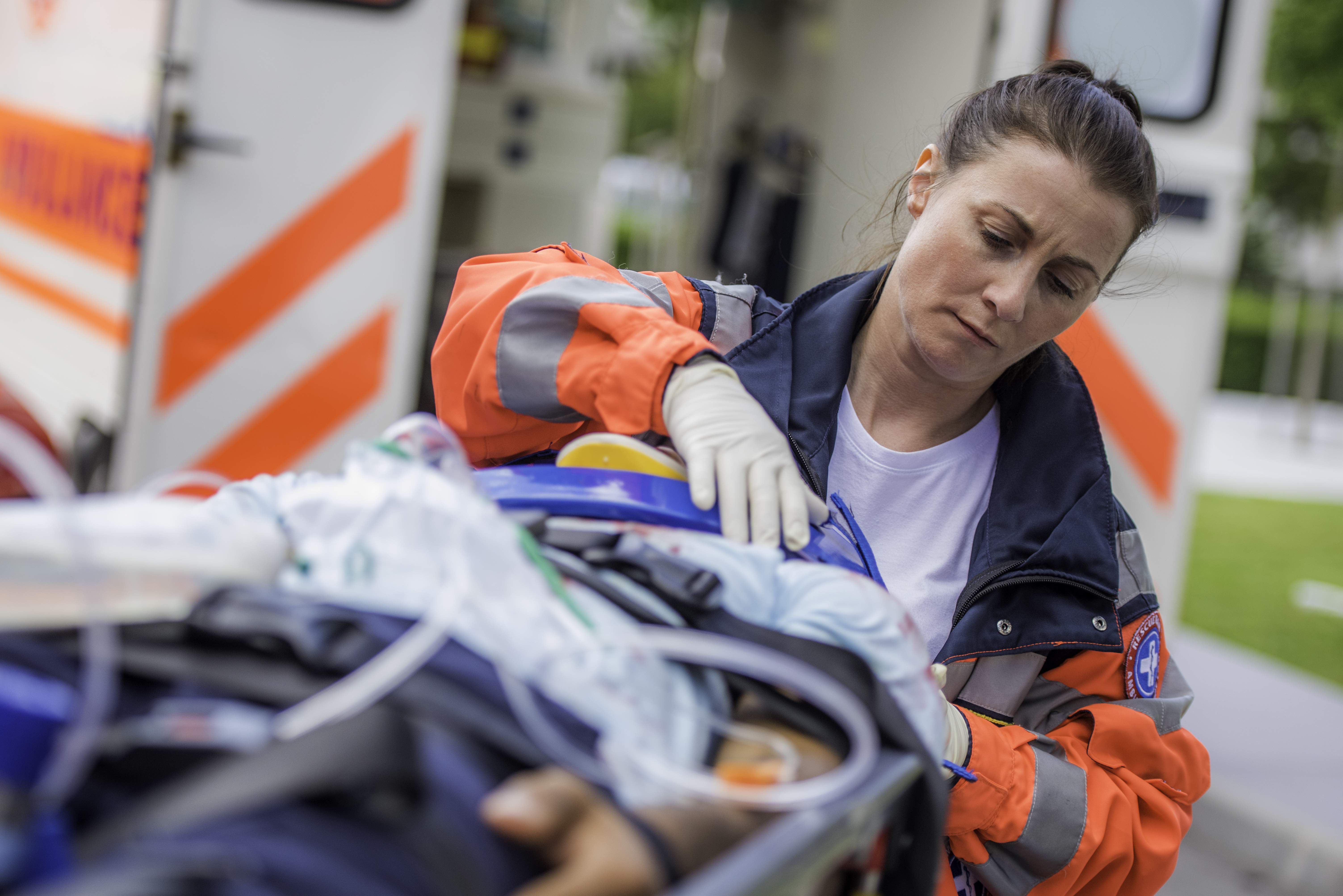 Female paramedic with patient